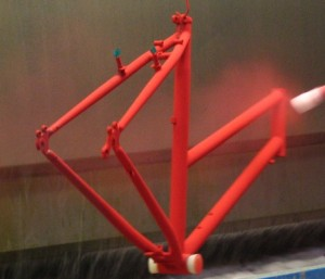 Gary Fisher frame being powder coated in red